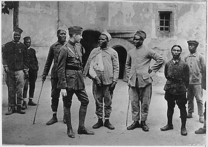 Convalescent Moroccan soldiers telling their war experience to an American Red Cross worker.