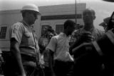 """Man speaking to an officer of the Neshoba County Sheriff's Department, during the """"March Against Fear"""" through Mississippi begun by James Meredith."""