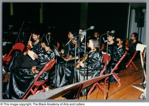 Photograph of some student performers seated onstage Christmas/Kwanzaa Concert Hallelujah Hip Hop Concert, December 1995