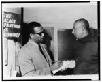 [Stanley S. Scott (l) interviewing Stokely Carmichael at Student Non-Violent Coordinating Committee (SNCC) headquarters in New York]
