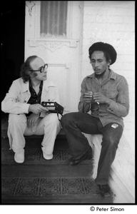 Bob Marley being interviewed on the steps of his home