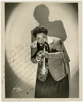 """[Tiny Davis, member of """"Sweethearts"""", playing trumpet] [Black-and- white photoprint]"""