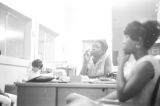 Young women seated at desks in an office, possibly the headquarters of the SCLC in Montgomery, Alabama.