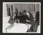 [Roy Wilkins and President Lyndon B. Johnson in the White House reviewing some of the strategies employed to secure passage of the Voting Rights Act of 1965]
