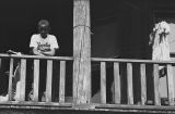 Jasper Wood Collection: Boy in Cleveland Indians shirt on porch