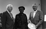 Blues musician Jesse Fuller standing with KPIX general manager Al Constant (left) and former museum director John Peetz during concert at the Oakland Museum