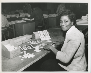 Woman packaging buttons