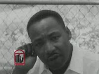WSB-TV newsfilm clip of Dr. Martin Luther King, Jr. speaking about nonviolence at an outdoor press conference after violence during a night march in Albany, Georgia, 1962 July 25