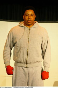 Vincent Cook Standing on Stage Ali...The Man, The Myth, The People's Champion