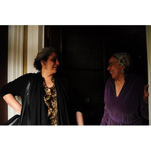 Adelaide Cromwell laughs with Lolita Parker, Jr. in the doorway of Cromwell's home.