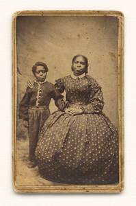A cabinet card of a woman with a young boy