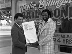 Taylor Billingslea posing with Bob Farrell in front of Billingslea Bail Bonds, Los Angeles, 1983