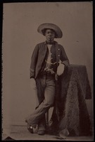 Tintype of one unidentified buffalo soldier with buffalo hide