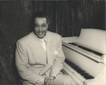 [Duke Ellington sitting at the piano. Black-and-white photoprint.]