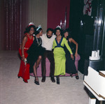 Berry Gordy and others posing for a group portrait at a New Year's Eve party, Los Angeles, 1971