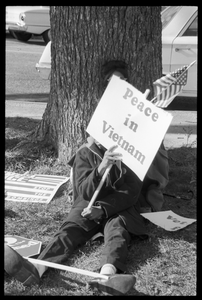 Young African American antiwar protester holding a sign reading 'Peace in Vietnam': Washington Vietnam March for Peace