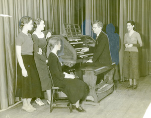 Girls listening to organist (Abbot Academy)