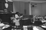 Woman testifying before the Senate Rules Committee in the Senate chamber of the Capitol in Montgomery, Alabama, during a debate on the Equal Rights Amendment (ERA).