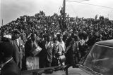 Car and crowd at a service for Martin Luther King, Jr.