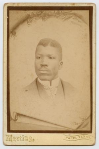 Photograph of a Young African-American Man in a Coat and Tie
