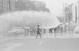 Firemen spraying civil rights demonstrators with fire hoses in downtown Birmingham, Alabama.