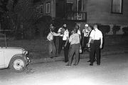 Roosevelt Barnett speaking to police officers during a civil rights demonstration in Montgomery, Alabama, after they had blocked a march to the Capitol.