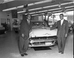 Men at Lincoln car dealership, Los Angeles, 1956