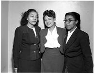 Maida Springer (Kemp) poses with two other African American women