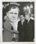 Sara Pelham Speaks, of New York, activities director of black women's groups for the Eastern Division of the Republican National Committee's Publicity Department, with Francis E. Rivers (right), Eastern Director of the Colored Division, and James R. White (center), National Director of Business, Trade and Industrial Publicity, in New York City, 1940. A photo montage of Republican presidential candidate Wendell L. Willkie is in background