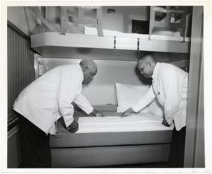 Porters preparing bed in Pullman Sleeper : photoprint