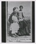 Portrait of Sea Island School teacher Miss Harriet W. Murray, with students Elsie and Puss, Feb. 1866