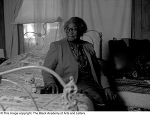 Photograph of Osceola Mays in her bedroom #2 Dallas/Fort Worth Black Living Legends Dallas/Fort Worth Black Living Legends, 1991
