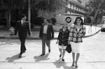 California Chicano News Media Association award recipient walking with Félix Gutiérrez, Los Angeles, 1994