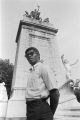 African American man standing in front of the U.S.S. Maine Monument in Central Park in New York City.