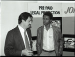 Association of Independent Printers event attendees talking near a display, Los Angeles, 1986