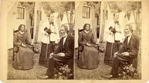 Stereograph of two women and one man in front of a tent, ca. 1878