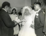 African American couple perform wedding vows