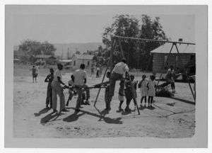 Photograph of African American students playing on a playground, Manchester, Georgia, 1953
