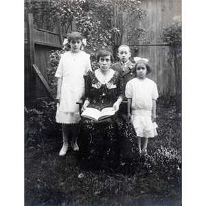 Family portrait, Florence Glover reads with her children