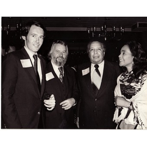 An unknown man, Walter Dunfey, Paul Parks, and Coretta Scott King.