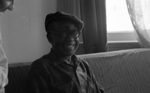 Jesse Fuller sitting on sofa smiling