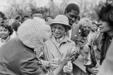 Admirers greeting Rosa Parks on her 75th birthday at Rosa Parks Day in Tuskegee, Alabama.