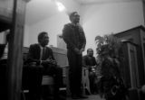 Richard Boone standing behind a podium after speaking to an audience at First Baptist Church in Eutaw, Alabama.
