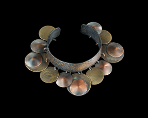 Cuff bracelet with dangling orbs designed by Winifred Mason Chenet