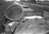 Trailer full of cotton being pulled by a tractor down a paved road near Mount Meigs in Montgomery County, Alabama.