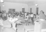 Audience leaving the auditorium of a church building, possibly after a civil rights meeting in Montgomery, Alabama.