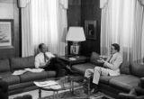 Birmingham Mayor Richard Arrington talking to a man in his office at city hall in Birmingham, Alabama.