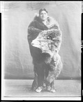 Stacey Matlock, Chaui Pawnee chief, wrapped in bear skin, 1904