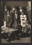 """[Group portrait of African American men and woman with """"Overcome evil with good"""" and """"Live wires"""" banners]"""