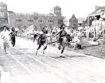 Tennessee State University Tigerbelles Wilma Rudolph and Martha Hudson running at the Penn Relays